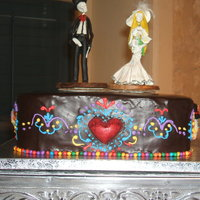 Dia De Los Muertos Groom's Cake   Hand piped sides with poured white chocolate heart. Toppers were purchased by couple.