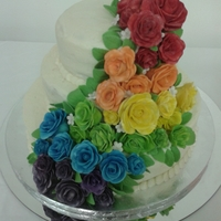 Rainbow Rose Wedding Cake  Crusting cream cheese buttercream icing with hand painted roses. Roses were done in white and painted with colored luster dust. Includes...