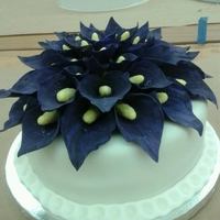 Purple Calla Lily Cake  This is my Wilton course 3 final cake. I spent about 30 hours making over 50 callas. The callas are fondant/gumpaste dyed purple. I then...
