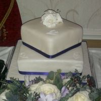 Wedding Cake A two tier square offset wedding cake, the top tier is lemon and poppyseed with lemon buttercream, the bottom tier is vanilla sponge with...