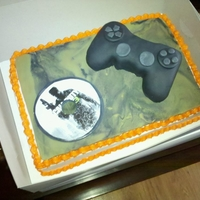 Playstation Cake 1/4 sheet marbled camo fondant. Rice krispy threat covered in fondant controller
