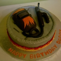 Welders Cake Welding helmet and lead made of RK treats. The cake covered with buttercream frosting.