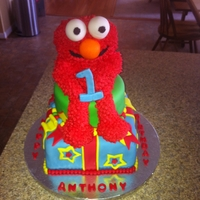 Elmo Cake   vanilla cake with strawberry filling covered in fondant. The Elmo is made of rice crispy treats.