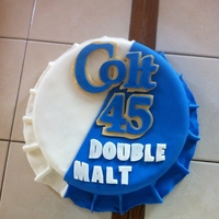 Happy Birthday  I made this bottle cap cake for my neice and nephew who have a birthday one day apart. Both of them are a fan of Colt 45 Double Malt. The...