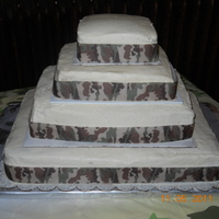 My 1St Wedding Cake With Camo This was a huge cake ordered by friends with a camo themed wedding. It was awesome. A lot of work but had fun and what a learning...