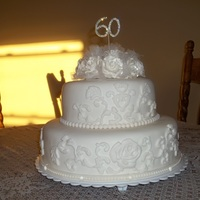 Anniversary Wedding Cake For 60Th I used the Wilton silicone molds.It was my first attempt at using them and I think it came out nice. It is difficult to see but there were...