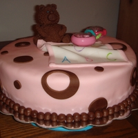 Girl Baby Shower Cake  Fondant covered, fondant blanket, chocolate fondant teddy bear, and a real rattle, which was the request since that rattle was a gift to...
