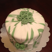 Green And White Cake With Roses Green and white folded fondant cake with flowers