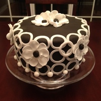 Black And White Circles And Flowers Black and white fondant with fondant flowers