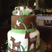 Deer Cake Green, white, brown fondant with deers and camo bow