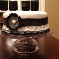 Black And White Ruffles With Flower   Black and white ruffles and flower fondant
