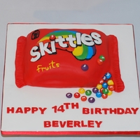 Skittles Cake i was asked to make a skittles cake, bought a packet of skittles candy and copied it from there