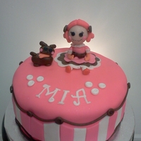 Lalaloopsy Cake !!!! Red velvet cake filled with cream cheese frostin,covered in MMF,lala loopsy and dog are made of fondant.My client saw a picture here on C.C...