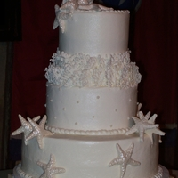 Beach Cake Themed wedding cake, adorned with starfish and coral