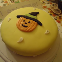 Happy Halloween Quick Lemon Cake   Inside - lemon cake with lemon buttercream. Draped in and decorated with fondant.