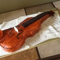 Violin Cake Covered In Fondant Gumpaste Decorations Musical Notes Were Printed On Edible Paper Everything Is Edible Except For The Strin Violin cake. Covered in fondant. Gumpaste decorations. Musical notes were printed on edible paper. Everything is edible except for the...