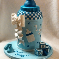 Baby Bottle Cake Chocolate And White Cake With Vanilla Buttercream Covered In Fondant All The Details Were Made In Gumpaste I Made The Bo Baby bottle cakeChocolate and white cake with vanilla buttercream. Covered in fondant. All the details were made in gumpaste. I made the...