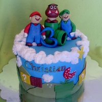 Super Mario Brothers Super Mario Brothers cake, strawberry cake with vanilla buttercream and fresh strawberry filling.