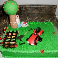 Outdoor Cake  Was actually made for my grandpa. He loves mowing grass, his veg garden, pciking apples from apple trees, and his sidekick aka dog Kenzie....