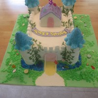Fairy Castle  Chocolate cake filled with raspberries and frosted with butter cream. Castle cake with 4 turrets made out of rice krispies. Covered in...