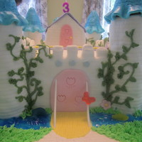 "Alice's Palace I made this fairy castle cake for my great niece Alice. It is layered 9x13"" cake with buttercream and fondant. The walls, turrets, and..."