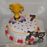 This Cake Was Made For A Girl Who Has Won A Trophy In Cycling And Skating Skates And Trophy Are Made With Gum Paste And Cycle Is Made With... This cake was made for a girl who has won a trophy in cycling and skating. Skates and trophy are made with gum paste and cycle is made with...