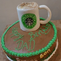 The Vanilla And Pineapple Cake Topped With A Starbucks Cup Which Is A Sinful Chocolate Truffle Cake The vanilla and pineapple cake topped with a Starbucks cup which is a sinful chocolate truffle cake.