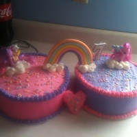 My Little Pony  Cakes done for a little girl's 7th birthday. One is white almond, the other devils food. Both are filled and frosted with different...