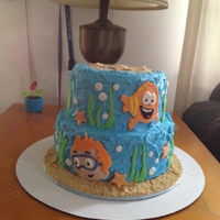 Bubble Guppies!!  Two tier Bubble Guppies cake done in buttercream with fondant accents. Top tier is chocolate cake and bottom tier is white. Sand is done...