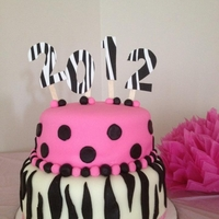Zebra And Hot Pink Cake! This was made for my granddaughters 8th grade graduation party She had wanted it for her birthday but it didn't happen.. Bottom layer...