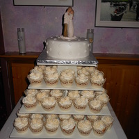 Mini Wedding Cake With Rose Covered Cupcakes