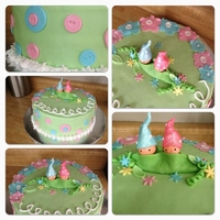 Baby Shower Gnome Pea Pod Cake! Customer wanted a boy and girl baby gnome on the cake for her twins baby shower. Everything is fondant or gumpaste.