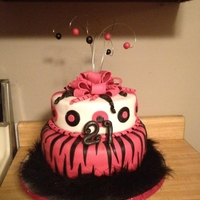 Zebra Pink And Black 21St Birthday Cake! 21st zebra cake with a bow on top and feather boa from michaels added around. I also added the glitter ribbon around the cake board!