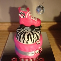 Zebra Print Roller Skate Cake This cake was for a party at a skating rink. The theme was skating diva! Skate is rice crispy treat. I added a disco ball and shimmer dust...