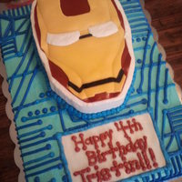 Iron Man made this cake for a little boy turning 4. Made to match the Iron Man 2 plates and stuff. French Vanilla cake with vanilla butter cream and...