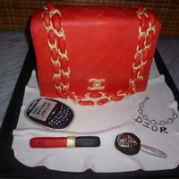 Chanel Bag   Dior Bracelet, Porsche car key, Mac Lipgloss and a blackberry along wid chanel purse cake