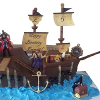 Pirate Ship Cake Made of 6-7 layers of homemade chocolate cake. Filled with homemade vanilla frosting. Carved and crumb coated with 2 coats of buttercream....