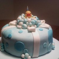 Rubber Ducky! This was my very FIRST cake I made with fondant a couple of years ago. I was inspired by a photo I saw and renovated it. 2 layers of cake,...