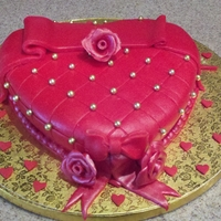 Be Mine! Cake covered in fondant, fondant decor and edible gold pearls.