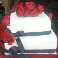 Romantic Wedding Cake Satin ribbon, real roses, white fondant, 2 tiers.