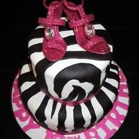 Hot Pink Zebra Bling Zebra print cake with hot pink details and high heeled shoe accents (not edible). Cake is strawberry cheesecake cake!