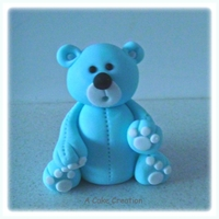 Baby Blue Teddy Bear Cake Topper baby blue teddy bear cake topper made from modelling paste.