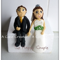 The Happy Couple Wedding Cake Toppers modelling paste bride and groom weddding cake toppers.