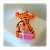 Tigger Cake Topper Tigger Cake Topper from 'Winnie the pooh' Made from gumpaste.