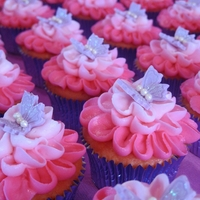 Butterfly Kissed Cuppies Cream Cheese icing on Strawberry cupcakes.