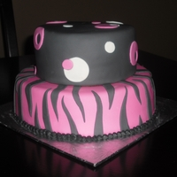 Black & Pink Zebra & Dots Black, pink & white 2 tier cake with zebra print and dots.