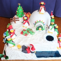 Penguin Christmas Cake My attempt at the penguin Christmas cake that I saw on Cake Central. First time making all of these elements as well as using isomalt for...