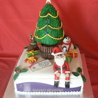 My First Christmas Cake Made for a client who is a publisher so it had their logo on (which I've had to blur out)