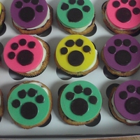 Doggie Cupcakes These were for the humans at a doggie party...mocha cupcakes with ganache and french vanilla buttercream. And a chocolate disk on top.