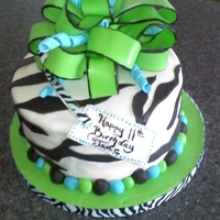 Green Zebra Cake Mint Chocolate Chip cake with fudge filling, fondant accents and bow.